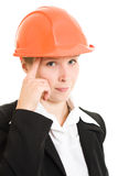 Thinking businesswoman in a helmet stock images