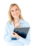 Thinking businesswoman holding a clipboard Stock Image