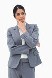 Thinking businesswoman looking to the side. Against a white background Royalty Free Stock Photos