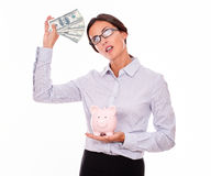 Thinking businesswoman with pink piggy bank Royalty Free Stock Photo