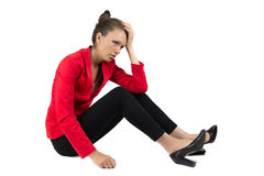 Thinking businesswoman sitting on the floor Stock Images