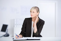 Thinking businesswoman Royalty Free Stock Photography