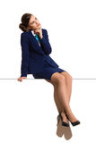 Thinking Businesswoman Is Sitting On Top Of A Banner stock images