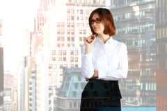 Thinking busuinesswoman on city background Stock Photography