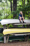 Thinking on canoes Stock Images