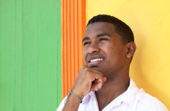 Thinking caribbean guy in front of a colorful wall Royalty Free Stock Photography