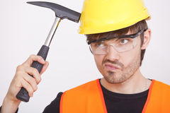 Thinking carpenter with hammer Royalty Free Stock Images