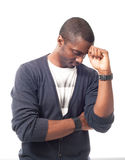 Thinking casual dressed afro-american man with white t-shirt. Stock Photos