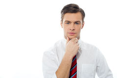 Thinking caucasian male model. Closeup portrait of a casual young businessman Royalty Free Stock Images