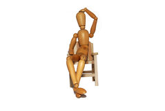 Thinking in a chair. Contemplating and thinking in a wooden chair Royalty Free Stock Images