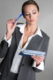 Thinking Checkbook Woman. Thinking business woman with checkbook royalty free stock images