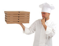 Thinking chef with boxes of pizza Stock Photo