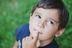 Thinking child. A little adorable child with thinking expression on face Royalty Free Stock Images