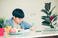 Thinking child bored and fed up doing his homework. Thinking child bored, frustrated and fed up doing his homework Stock Photography