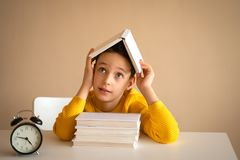 Thinking child bored, frustrated and fed up doing his homework.  stock images