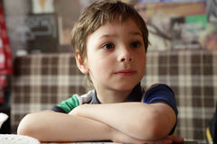 Thinking child in cafe Royalty Free Stock Photos
