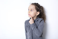Thinking child. Portrait girl looking up Royalty Free Stock Photography