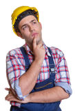 Thinking construction worker Stock Photo
