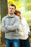 Thinking couple standing back to back Stock Photography