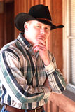 Thinking Cowboy in Black Cowboy Hat Stock Photos