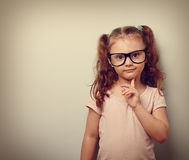 Thinking cute kid girl looking confident in eyeglasses. Vintage Royalty Free Stock Photos