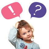 Thinking cute small kid girl with question and exclamation signs in bubbles Royalty Free Stock Images