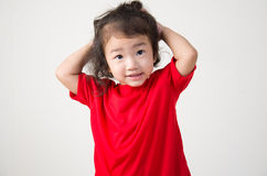 Thinking cute small kid girl Stock Images