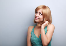 Thinking cute young blond woman looking up Royalty Free Stock Photos