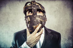 Thinking, dangerous business man with iron mask and expressions Stock Images