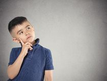 Thinking, daydreaming child boy Stock Photography