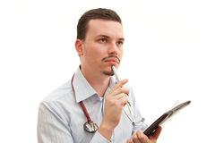 Thinking doctor. A young caucasian doctor thinks deeply Stock Image