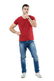 Thinking doubtful casual man with hands on chin looking at camera Royalty Free Stock Images