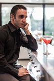 Thinking and drinking Royalty Free Stock Photos