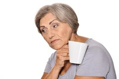 Thinking elderly woman with cup Royalty Free Stock Photography