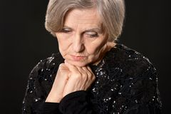 Thinking elderly woman Stock Image