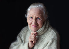Thinking elderly woman Royalty Free Stock Image