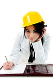 Thinking engineer. Engineer woman dreaming and taking notes Stock Photos