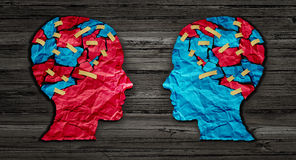 Thinking Exchange. And idea partnership business communication concept as a red and blue human head cut from crumpled paper sharing broken pieces as a creative stock illustration