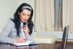 Thinking executive woman working home Stock Image