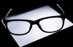 Thinking eyeglass Stock Images