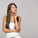Thinking female looking at copy space stock photography