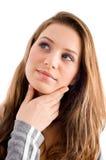 Thinking female looking upward stock photo