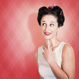 Thinking fifties pinup girl with old hairstyle Stock Images