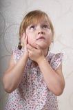 Thinking funny girl Stock Photo