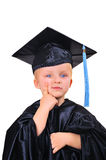 Thinking about future after graduation. Cute little boy in graduation gown thinking Stock Photo
