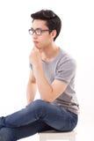 Thinking genius man studio shot, looking away Royalty Free Stock Images