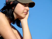 Thinking girl. Looking for answers in the horizon Royalty Free Stock Photography