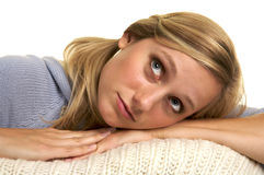 Thinking Girl. Pretty Blond laying down with a dreamy look on her face Royalty Free Stock Images