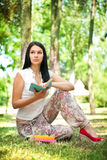 Thinking girl with book in park Stock Photo