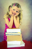 Thinking girl with books Stock Photography